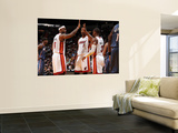 Charlotte Bobcats v Miami Heat: LeBron James, Chris Bosh and Dwyane Wade Prints by Andrew Bernstein