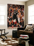San Antonio Spurs v Los Angeles Clippers: Tim Duncan and Eric Gordon Prints by Andrew Bernstein