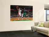 Toronto Raptors v Boston Celtics: Jerryd Bayless and Kevin Garnett Posters by Brian Babineau