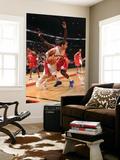 Philadelphia 76ers v Toronto Raptors: Jose Calderon and Jrue Holiday Poster by Ron Turenne