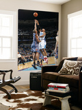 Charlotte Bobcats v New Orleans Hornets: David West and Boris Diaw Print by Layne Murdoch