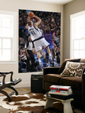 Detroit Pistons v Dallas Mavericks: Dirk Nowitzki and Jason Maxiell Prints by Glenn James