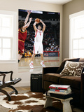 Cleveland Cavaliers v Houston Rockets: Luis Scola and Anderson Varejao Print by Bill Baptist