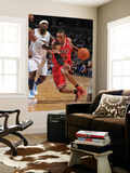 Chicago Bulls v Denver Nuggets: C.J. Watson and Ty Lawson Posters by Garrett Ellwood