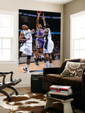 Phoenix Suns v Orlando Magic: Grant Hill, Vince Carter and Brandon Bass Prints by Andrew Bernstein