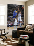 Golden State Warriors v Dallas Mavericks: Reggie Williams and Alexis Ajinca Posters by Glenn James