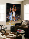 Denver Nuggets v Golden State Warriors: Dan Gazuric and Arron Afflalo Prints by Rocky Widner