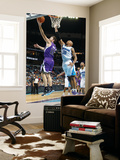 Sacramento Kings v New Orleans Hornets: Beno Udrih and David West Print by Chris Graythen