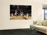Denver Nuggets v Toronto Raptors: Al Harrington and Amir Johnson Prints by Ron Turenne