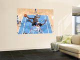 Orlando Magic v Denver Nuggets: Brandon Bass and Nene Prints by Garrett Ellwood