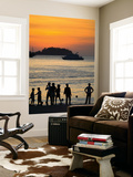 People on Patong Beach Silhouetted at Sunset Posters by Austin Bush
