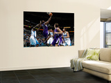 Sacramento Kings v New Orleans Hornets: Tyreke Evans and Emeka Okafor Prints by Chris Graythen