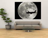 A Jet Plane Passes in Front of the Full Moon Above Surfside, Fla. Posters