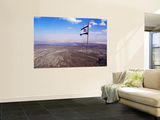 The Blue and White Flag of Israel, the Star of David Flies over the Deserts of Masad Print by Russell Mountford