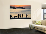 People on Patong Beach Silhouetted at Sunset Prints by Austin Bush
