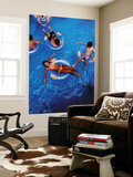 People Floating in Pool on Rubber Rings Posters by Richard l'Anson