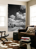 Cumulus Clouds Billowing over Texaco Gas Station along a Stretch of Highway US 66 Poster von Andreas Feininger