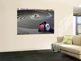 Couple Looking at the Spiral Fountain at the Sydney Convention Centre, Darling Harbour Prints by Manfred Gottschalk