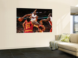 Cleveland Cavaliers v Miami Heat: Dwyane Wade and J.J. Hickson Prints by Victor Baldizon