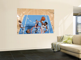 Minnesota Timberwolves v Denver Nuggets: Nene and Kevin Love Prints by Garrett Ellwood