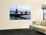 Three Boys Play on a Canoe (Pirogue) on the River in Mopti Prints by Dan Herrick