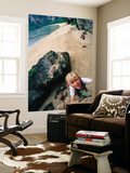 Young Boy Climbing Rocks Above Beach Print by Philip & Karen Smith