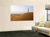 Man Standing on Sand Dune Looking Out on Arabian Desert Prints by Christian Aslund