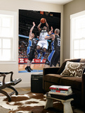 Orlando Magic v Denver Nuggets: Ty Lawson and Jason Williams Prints by Garrett Ellwood
