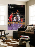 Houston Rockets v Sacramento Kings: Tyreke Evans and Shane Battier Print by Rocky Widner