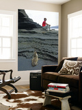 Sea Lion Cub Watching Visitor on Eroded Lava Rocks at Puerto Egas Posters by Manfred Gottschalk
