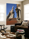 Saint Statue Decorating Corner of House with Tower of Church of Our Lady in Background Posters by Bruce Bi