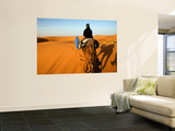 Traveller Riding Camel at Erg Chebbi Posters by Brian Cruickshank