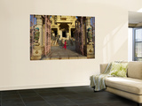 Child Running Past Entrance to Jain Temple Poster by Johnny Haglund