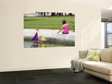 Girl with Toy Boat in Pond of Jardin Des Tuileres Prints by Lou Jones