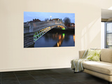 The Ha'Penny Bridge across the River Liffey Leading to Temple Bar Area Poster by Eoin Clarke