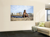 Woman Sitting on Beach with Surfboard at Bondi Beach Prints by Andrew Watson