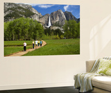 People Looking at Yosemite Falls from Wooden Walkway Print by Emily Riddell