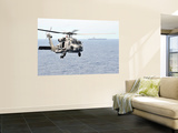 An Mh-60R Seahawk Helicopter in Flight over the Pacific Ocean Poster by  Stocktrek Images