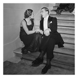 Vogue - May 1935 - Elegant Couple Talking on Staircase Regular Photographic Print by Roger Schall