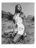 Vogue - June 1968 - Veruschka Kneeling in the Desert Regular Photographic Print by Franco Rubartelli