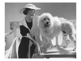 Vogue - July 1934 - Isabel Johnson Sitting with Poodle Premium Photographic Print by Edward Steichen