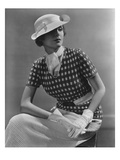 Vogue - January 1935 - Woman in Knitted Sportswear and White Hat Photographic Print by Lusha Nelson
