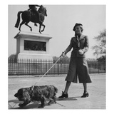 Vogue - October 1935 - Dog Walking in Paris Regular Photographic Print by Roger Schall