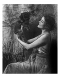 Vanity Fair - April 1921 - Woman Holding a Pekingese Dog Aloft Premium Photographic Print by Arnold Genthe