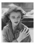 Vogue - August 1953 - Woman on Street Clutching Herself Regular Photographic Print by Karen Radkai