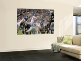 New York Giants and New England Patriots - Super Bowl XLVI - February 5, 2012: Eli Manning Prints by Ben Liebenberg