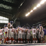 New York Giants and New England Patriots - Super Bowl XLVI - February 5, 2012: Giants Huddle Photographic Print by Marcio Jose Sanchez