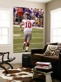 New York Giants and New England Patriots - Super Bowl XLVI - February 5, 2012: Eli Manning Posters by Michael Conroy