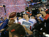 New York Giants and New England Patriots - Super Bowl XLVI - February 5, 2012: Eli Manning Photographic Print by Ben Liebenberg