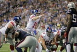 New York Giants and New England Patriots - Super Bowl XLVI - February 5, 2012: Eli Manning Photographic Print by Ben Liebenberg
